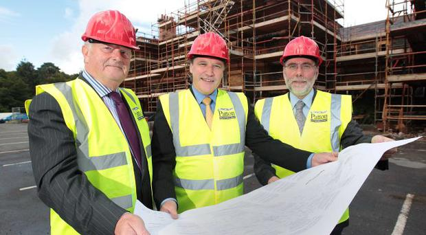 (from left) Dan Harvey, chair of the Board of Trustees, National Museums Northern Ireland, Tim Cooke, Director of National Museums Northern Ireland and Culture Minister Nelson McCausland look over plans for Cultra Manor's major refurbishment.