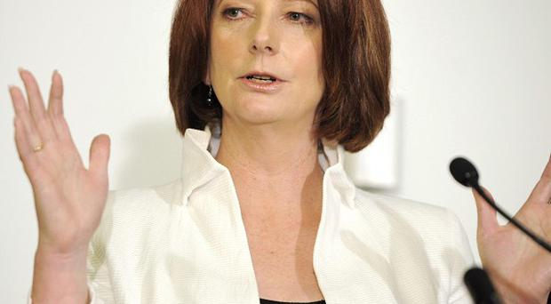 Australian PM Julia Gillard addresses the media after her Labour Party formed a minority government (AP)