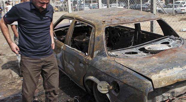 Six people have been killed in two separate bomb attacks in Baghdad (AP)