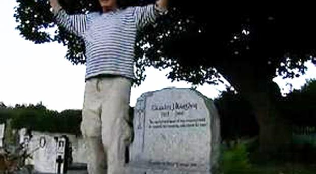 Vincent Keaney dances on the late Taoiseach Charles Haughey's grave in Sutton, north Dublin
