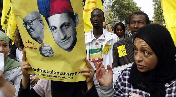 Protesters marched in Paris in September over President Nicolas Sarkozy's expulsions of Roma