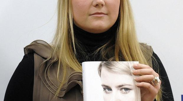 Natascha Kampusch poses with her book 3,096 Tage (3,096 Days) in Vienna (AP)