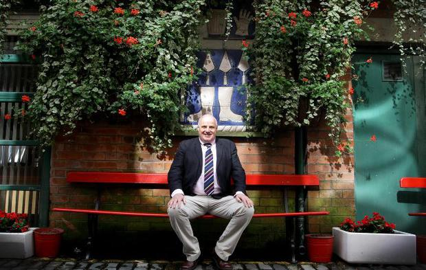 Willie Jack, the owner of the Duke of York bar pictured in the ally-way outside the Duke of York which he has made so colourful and appealing