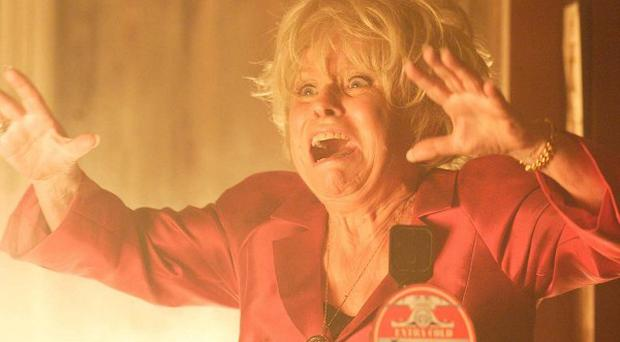 Peggy Mitchell (Barbara Windsor) watches the fire with horror