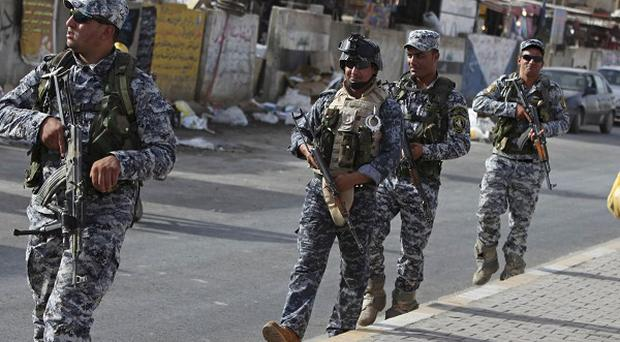 Iraqi security forces patrol the area near the prison four prisoners with links to al Qaida escaped from