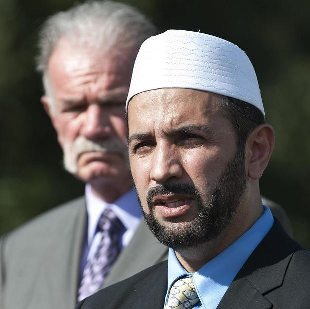 Imam Muhammad Musri of the Islamic Society of Central Florida with Pastor Terry Jones (AP)