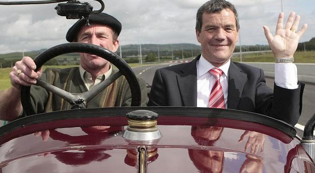 Transport Minister Noel Dempsey (right) travelled in a vintage car on the new section of the M9