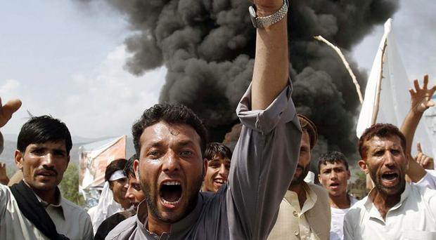 Afghans shout anti-US slogans during a protest against a pastor's plan to burn the Koran (AP)