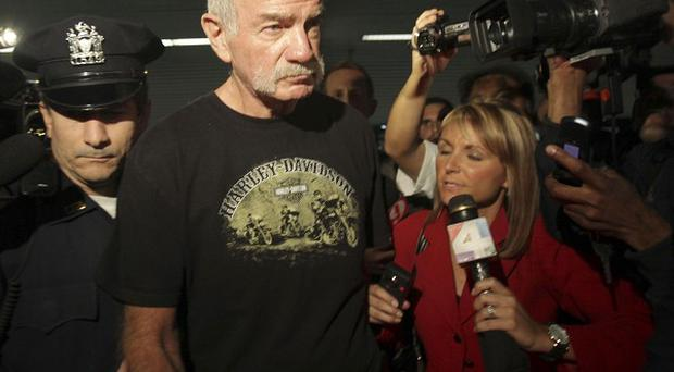 Pastor Terry Jones is surrounded by reporters as he arrives at Laguardia airportin New York. (AP)