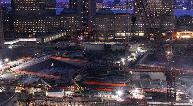 Construction crews work at site of the World Trade Centre, as New York City prepares for the 9th anniversary of the 9/11 terrorist attacks
