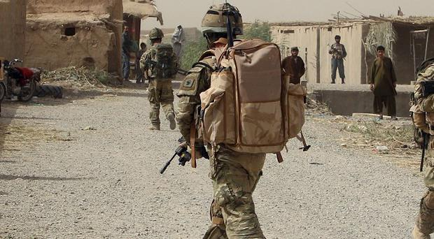 A British soldier has died in a hospital in the UK after being shot in Afghanistan, the MoD said