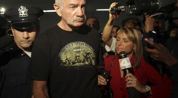 Pastor Terry Jones is surrounded by reporters as he arrives at Laguardia airport in New York. (AP)