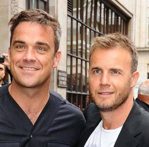 Robbie Williams (left) and Gary Barlow will perform together on Sunday