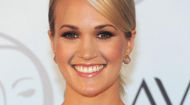 Carrie Underwood married professional hockey player Mike Fisher in the summer