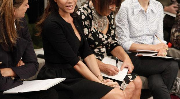 Victoria Beckham makes an appearance at her Spring 2011 collection, in New York (AP)