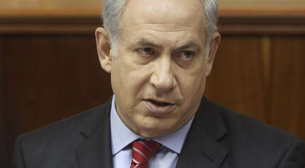 Benjamin Netanyahu said restrictions on West Bank settlements will not remain in place, but there will still be some limits on construction (AP)