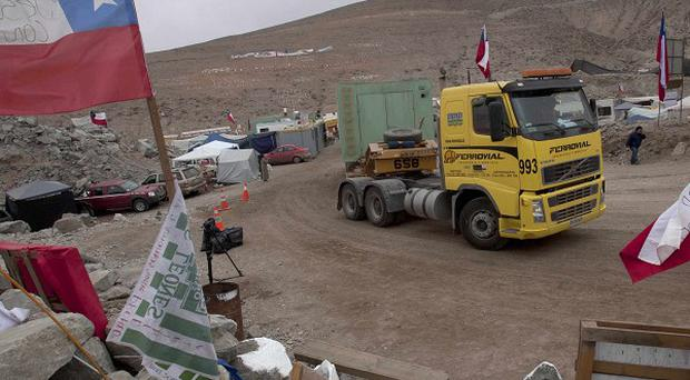 A truck carrying pieces of the third drill that will be used in the rescue of 33 trapped miner arrives at the San Jose mine in Copiapo (AP)