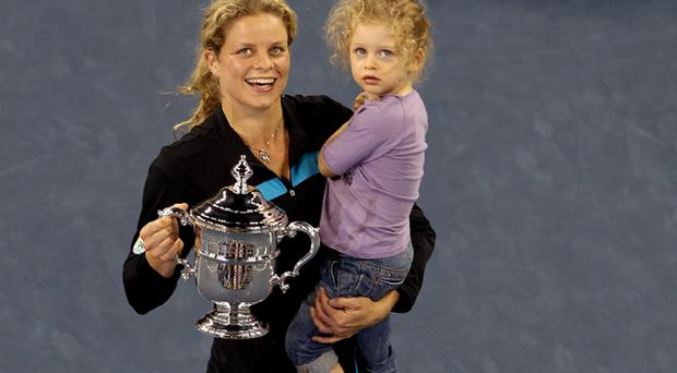 Kim Clijsters of Belgium and daughter Jada pose with the championship trophy after Clijsters defeated Vera Zvonareva of Russia during their women's singles final on day thirteen of the 2010 US Open