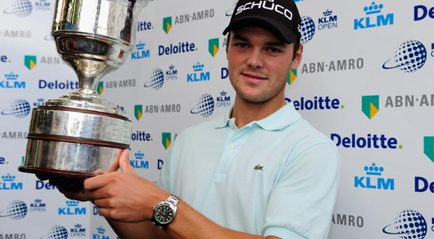 Martin Kaymer of Germay holds the trophy after winning The KLM Open Golf at The Hillversumsche Golf Club