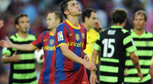 David Villa of Barcelona trudges off the pitch at the end of the La Liga match between Barcelona and Hercules at the Camp Nou stadium