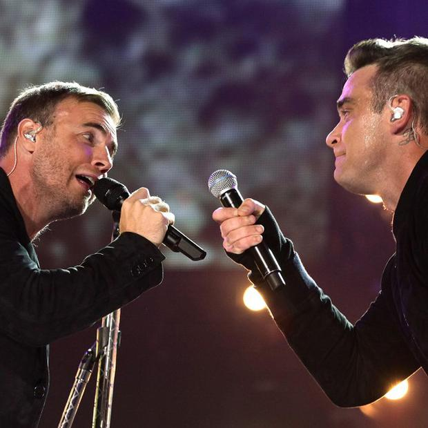 Robbie Williams and Gary Barlow performing at the Help For Heroes Concert at Twickenham Stadium