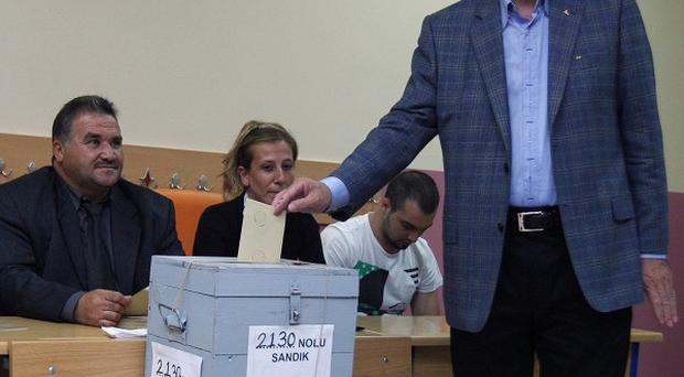 Turkish PM Recep Tayyip Erdogan casts his vote in the referendum on changes to the constitution (AP)