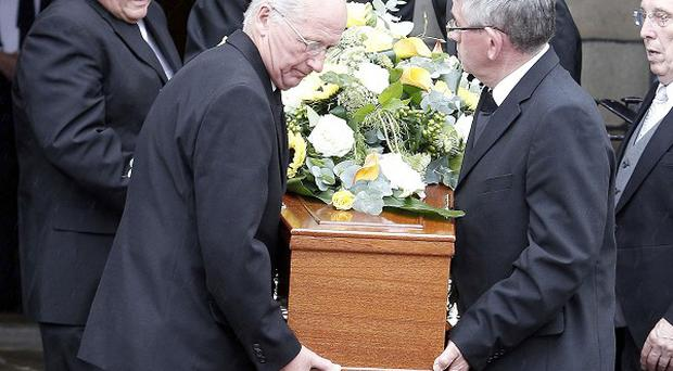 The coffin of Sir Cyril Smith MBE leaves Rochdale Town Hall after his funeral