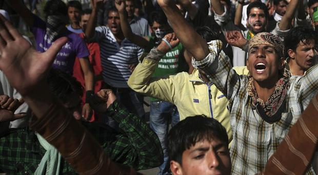 Kashmiri mourners shout slogans during the funeral of Nisar Ahmad Kuchay who died during a protest in India(AP)