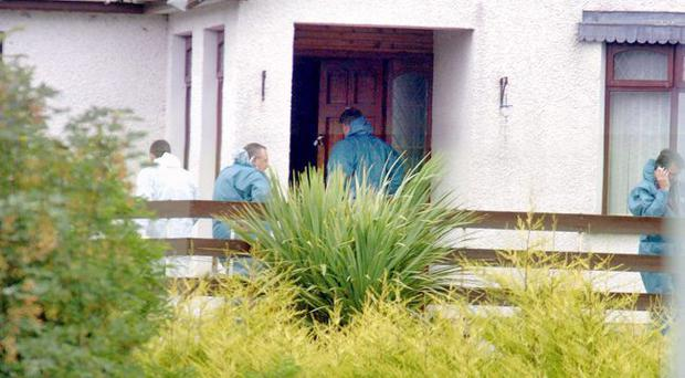 Hunt for clues: Forensic experts at Paul and Jacqueline Crymble's house