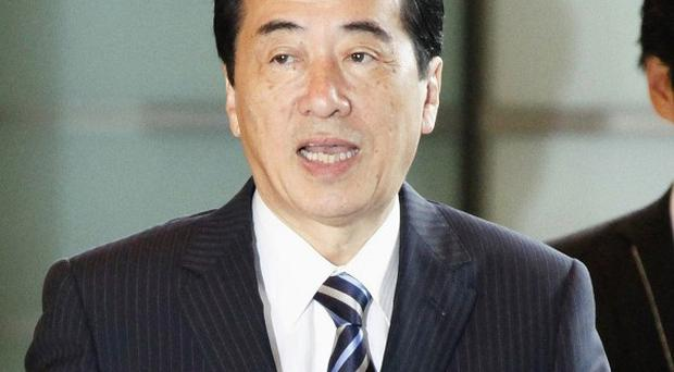 Japanese Prime Minister Naoto Kan has survived a challenge to his leadership