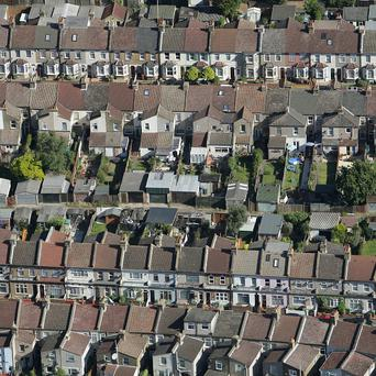 Public service spending cuts could add to the problems facing the Northern Ireland housing market, according to a report