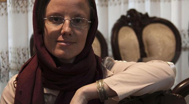 American hiker Sarah Shourd, 32, poses for a photograph at Mehrabad airport, prior to leaving Tehran (AP)
