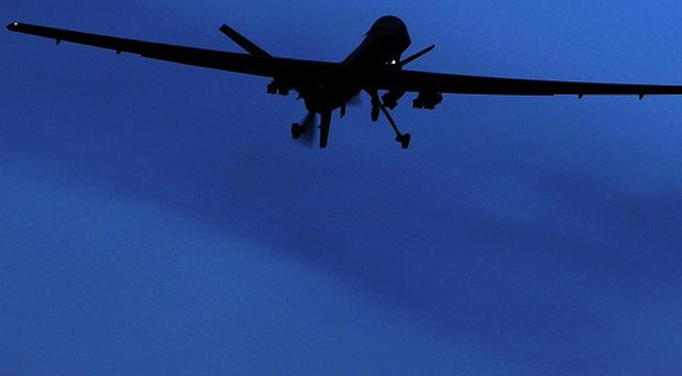 A US Predator drone flies above Kandahar air field in southern Afghanistan (AP)