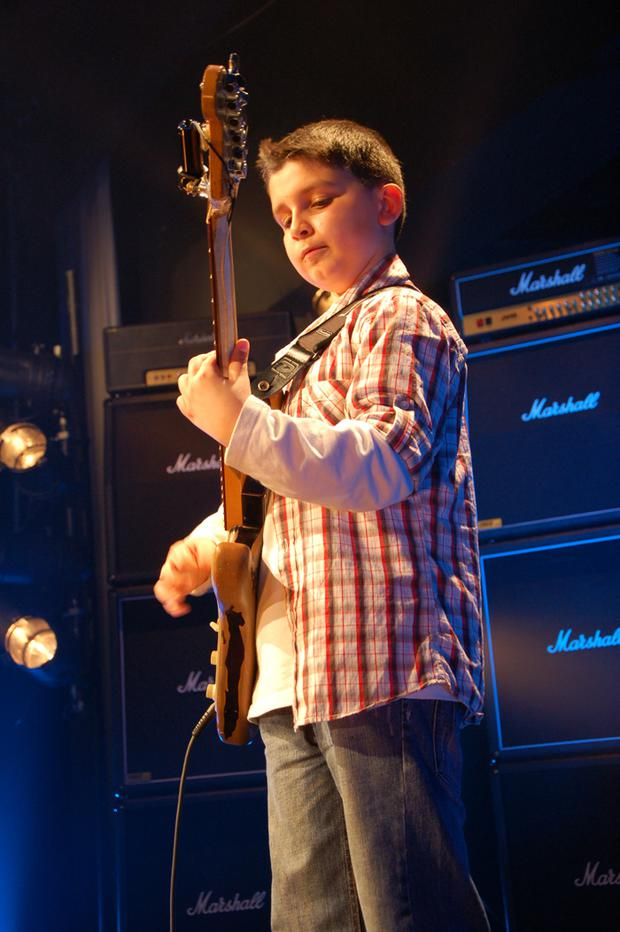 Young Andreas Varady shows off his skills on the fretboard