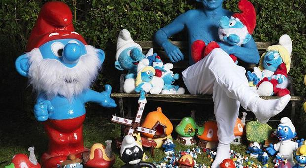 Stephen Parkes from Nottingham poses with his record-breaking collection of Smurf memorabilia