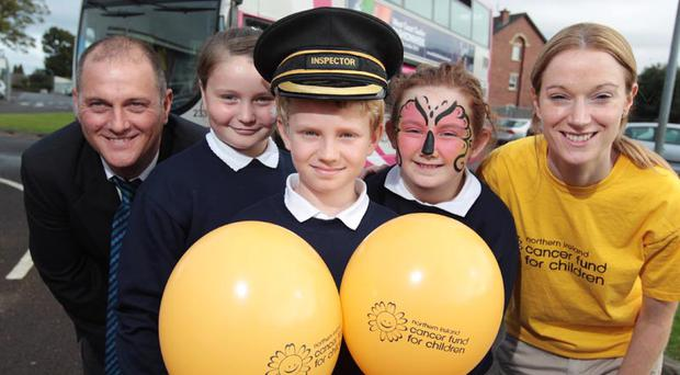 P7 pupils from Forge Integrated Primary School in south Belfast join Translink Metro inspector Eugene Dinnen and Northern Ireland Cancer Fund for Children schools' fundraiser Rachel Burgoyne to launch the Northern Ireland Cancer Fund for Children school fun day Brian Thompson/ Press Eye