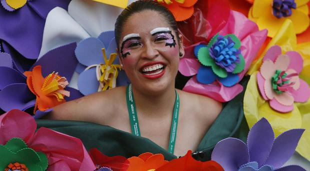 A dancer dressed as a bouquet of flowers performs during the bicentennial parade in Mexico City (AP)