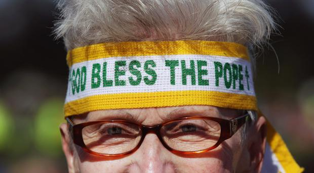 Pilgrims gather before the arrival of Pope Benedict XVI for the Papal Mass at Bellahouston Park on September 16, 2010 in Glasgow, Scotland