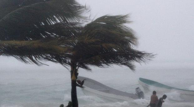 Fishermen try to secure their boats as Tropical Storm Karl arrives (AP)