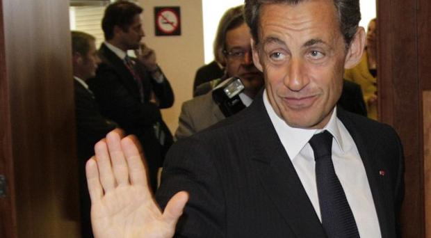 French President Nicolas Sarkozy arrives at EU summit in Brussels amid controversy over the expulsion of Roma communities in France (AP)