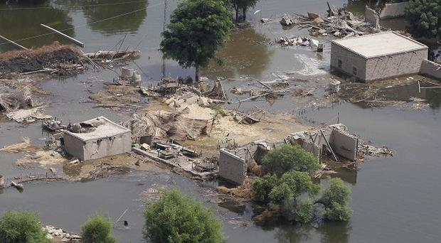 The US envoy to Pakistan said the world will only be able to fund around 25 percent for rebuilding the country (AP)