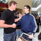 Springbok and Ulster rugby new signing Ruan Pienaar (right) is greeted by fellow countryman and teammate Johann Muller at Belfast City aiport