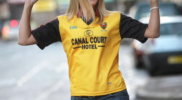 Gayle Ritchie models the Down Final shirt