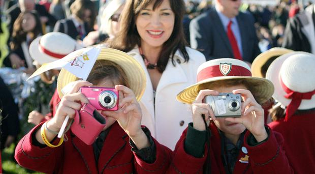 Children with their cameras await the arrival of Pope Benedict XVI for his visit to St Mary's University College, Twickenham, in south west London