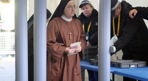 A nun passes through a security checkpoint during preparations for Pope Benedict XVI visit to St Mary's University College, Twickenham, in south west London