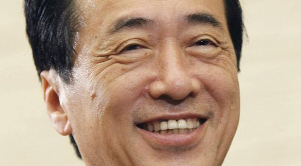 Japanese Prime Minister Naoto Kan speaks to reporters at the premier's office in Tokyo