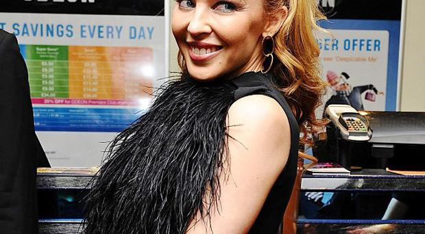 Kylie Minogue arrives for the UK premiere of The Kid