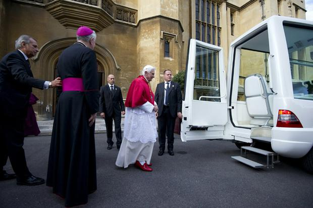 Pope Benedict XVI leaves Lambeth Palace in the 'Popemobile' for the short journey to Westminster Hall