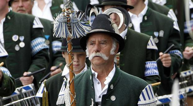 Bavarian musicians perform during the opening ceremony of the 'Historical Wiesn' in Munich (AP)