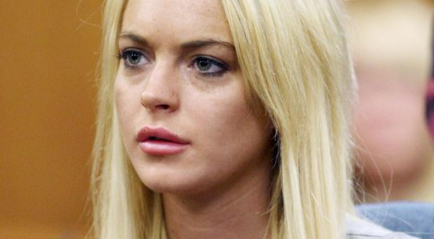 Lindsay Lohan listens during a court hearing in Beverly Hills, California (AP)